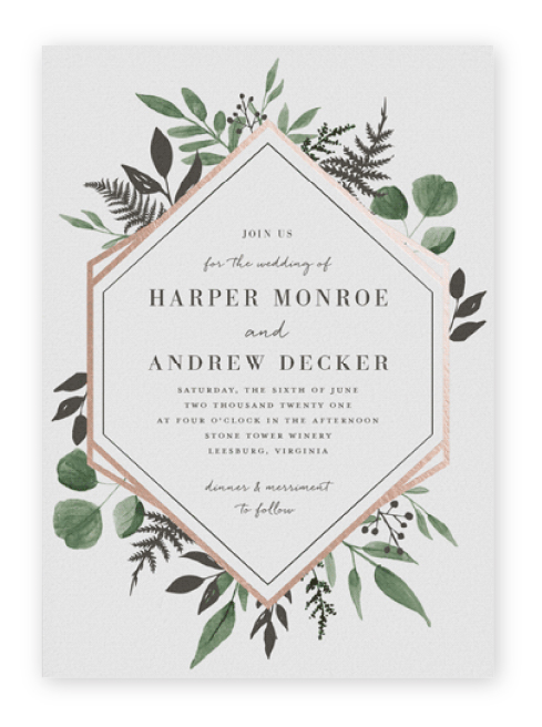 Wedding invitation with a rose gold foil and eucalyptus greenery frane.