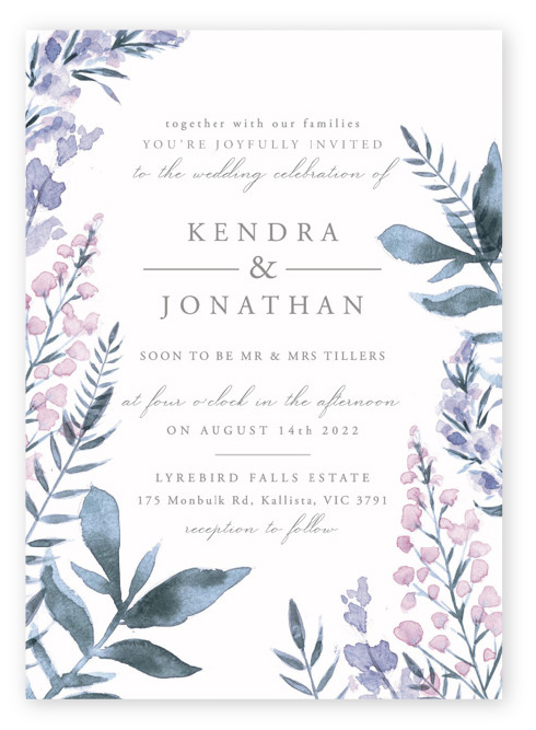 Romantic purple spring wildflower wedding invitations: watercolor flowers decorate the sides and bottom of the invitation with soft gray text in between.