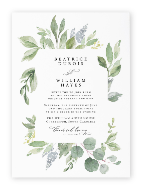 Watercolor eucalyptus leaves and soft lilac elements frame modern serif and script wording in these greenery wedding invitations from Etsy.