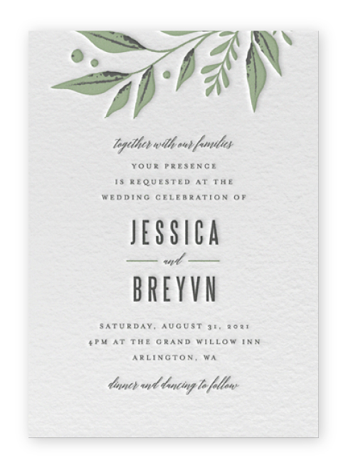 Letterpress greenery wedding invitations from Minted with green leaves coming in from the top, and bold text in black below.