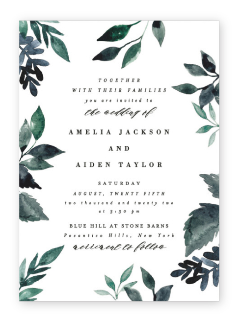 Dark green watercolor leaves frame the edges of these dramatic botanical invitations from Minted.